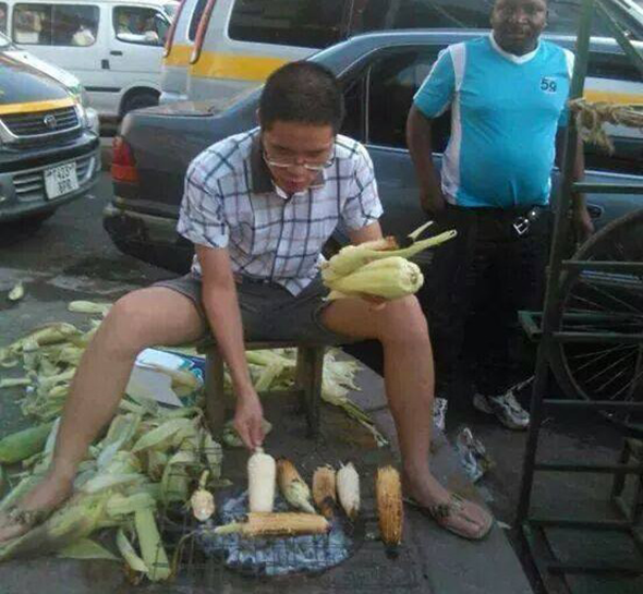 chinese-man-roasting-maize
